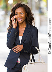 african woman talking on mobile phone
