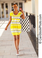 african woman with shopping bag in mall