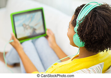 happy african woman with tablet pc and headphones - people, ...