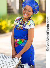 happy african zulu woman with shopping bags in mall