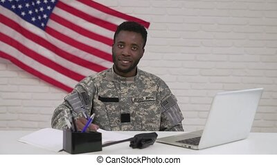 Happy afro-american officer during working process in office...