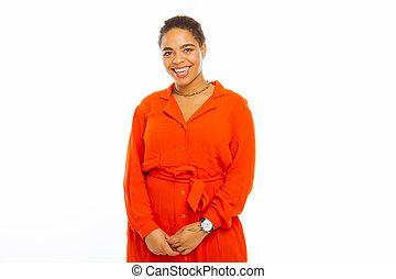 Happy afro American woman wearing an orange dress