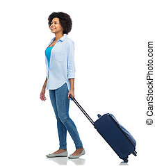 happy afro american woman with carry-on travel bag