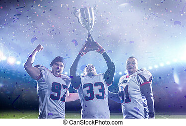 american football team with trophy celebrating victory in the cup final