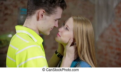 Happy and attractive young couple kissing