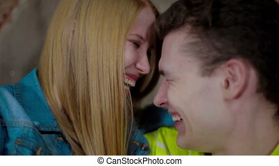 Happy and attractive young couple laughing