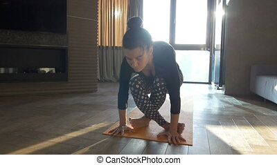 Happy and beautiful woman doing exercise of yoga at home.