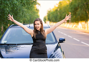 Happy and excited business woman in her car