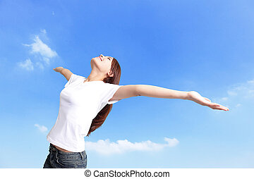 Happiness freedom concept. Woman happy smiling with arms up, asian beauty