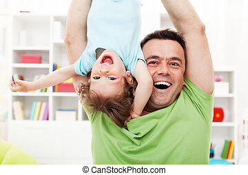 Happy and fun time with father - toddler child and his dad