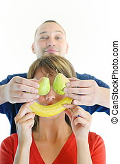 happy and healthy couple with fruits