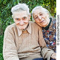 Happy and joyful old senior couple outdoor