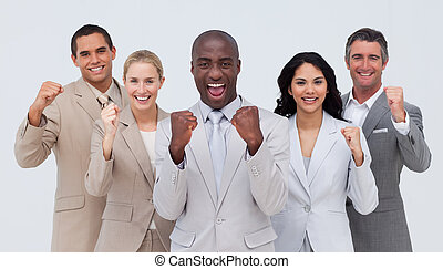 Happy and positive business team standing and smiling at the...