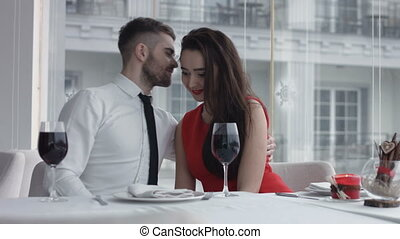 Happy and romantic young couple on a date at the restaurant