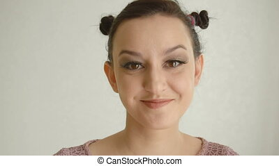 Happy and smiling girl with long lashes and brown eyes...