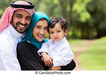 happy Arabic family - portrait of Arabic family at the park