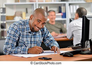 Happy architect at his desk