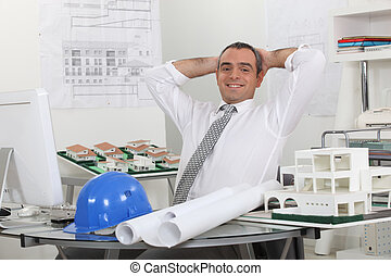 Happy architect in his office