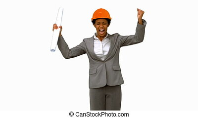 Happy architect raising arms on whi