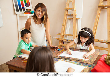Happy art teacher in class
