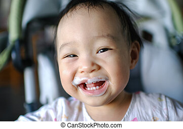 Happy Asian baby with diry mouth.