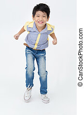 Happy asian boy is jumping