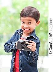 boy using a compact camera - Happy asian boy using a compact...