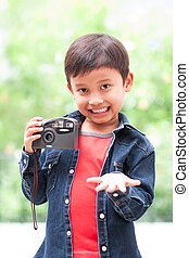 boy with compact camera. - Happy asian boy with compact ...