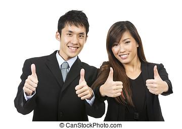 Happy Asian business team celebrating success.