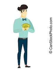 Happy asian businessman holding money.