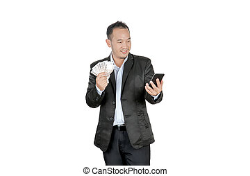 happy asian businessmen holding banknotes and looking at his cellphone, isolated on white