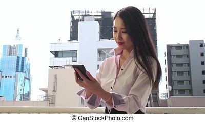 Happy Asian Businesswoman Talking