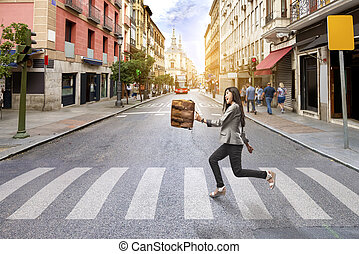 Happy asian businesswoman with briefcase walking crossing road on the way to office