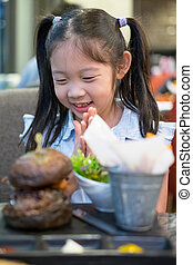 Happy Asian Child, Girl, Excited with Burger