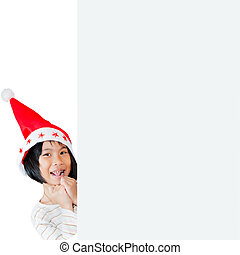 Happy Asian child wearing santa hat with white board.