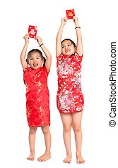 Happy Asian children holding red packet during Chinese New...