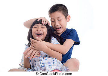 Happy Asian children playing together isolated on white.