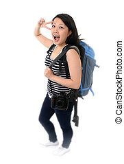 happy asian chinese tourist woman with backpack okay sign with hand