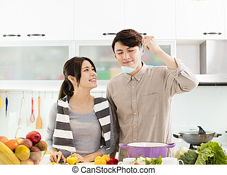 happy asian Couple cooking in the kitchen