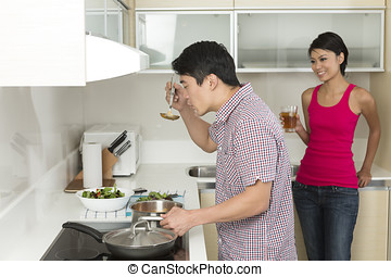 Happy Asian couple together at home - Happy Chinese couple...