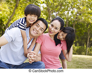 happy asian family - asian family with two children taking a...
