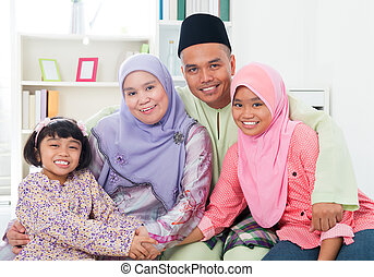 Happy Asian family at home.