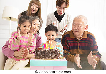 happy asian Family celebrating child's birthday