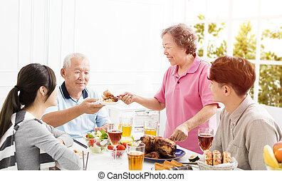 Happy asian family having dinner together