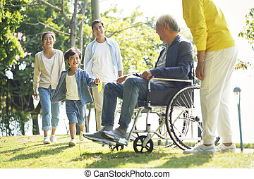 happy asian family having fun in park