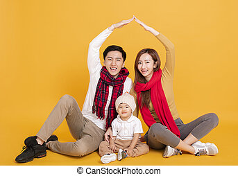 happy asian family in winter clothes