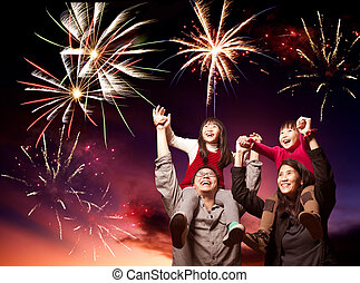 happy asian family looking fireworks