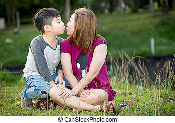 Happy Asian family ,mother with her son at park