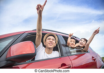 Happy asian family on  road trip in the car