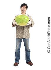 happy asian farmer holding watermelon full length isolated on white